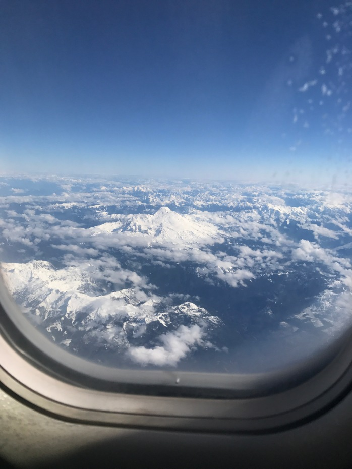 picture out the window of an airplane showcasing the white peak of a mountain near Vancouver, British Columbia.