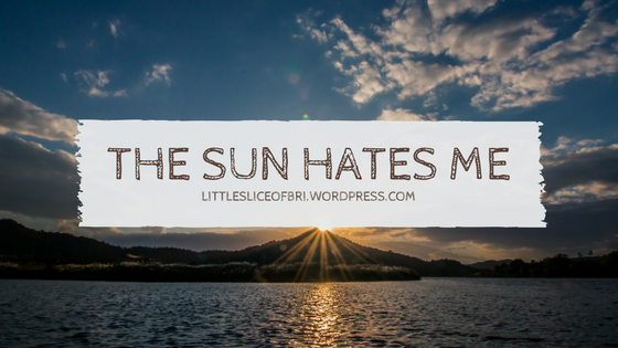 """A background of a sunset with the title of the blogpost """"The Sun Hates Me"""" blocking the sun."""