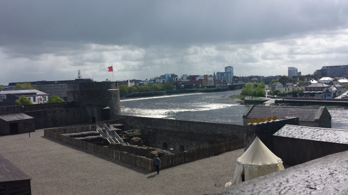 view of Limerick and the River Shannon from one of the towers of the castle. You can see the inside of the castle area as well, where the excavation goes below ground level.