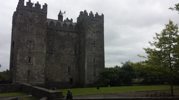 Picture of bunratty castle. It is square and has four towers.