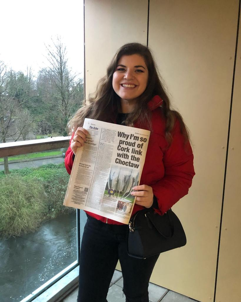 Jessica Militante holding her article in The Echo (in my much missed Cork apartment)